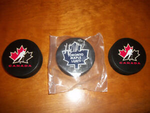 3 Hockey Pucks ( 2 Team Canada & 1 Toronto Maple Leafs Signed )