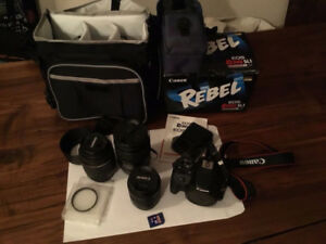 Canon 100D 18mp 1080p with 18-55, 55-200 and 16-300 lenses