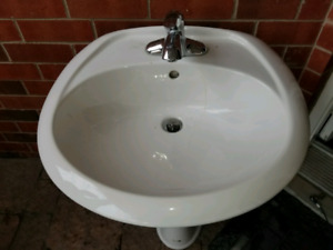 Bathroom Pedestal Sink Basin in White with Delta faucet