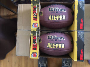 Two authentic NFL footballs