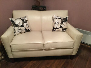 Two leather loveseats