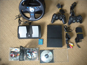 PS2 System/ Racing Wheel and 2 games