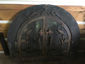 Fireplace front with glass doors screen