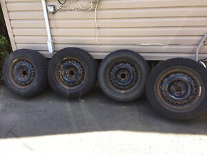 a set of 225/70R16 Winter Tires with rims