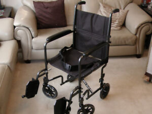 TRANSPORT CHAIR - NEW  ( SIMILAR TO WHEEL CHAIR)