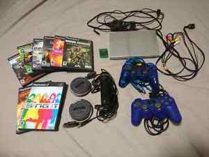 PS2 slim, works! Comes with games and accessories
