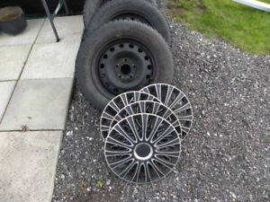 Snow tires and rims and hub caps $150.oo