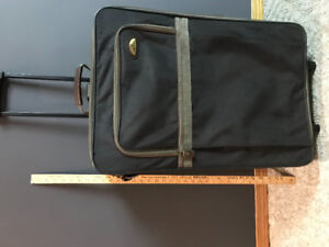 Large Black suitcase with adjustable handle and wheels!