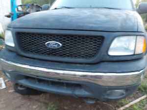 Chrome front bumper with fog light off 2002 f150