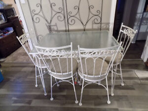 Wrought Iron Table & 4 Chairs  $100.00