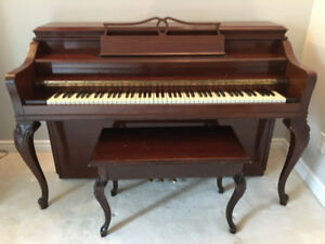 Maison and Risch Piano with intricate wooden detail.
