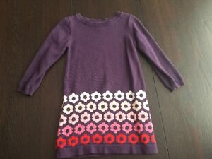 Long sleeved purple sweater dress with 4 rows of flowers on bott