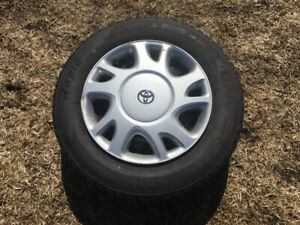 Snow tires with rims and caps