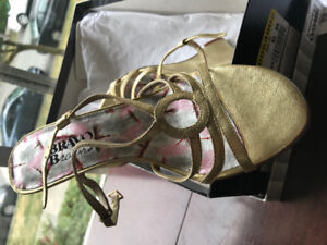 Gold wedge sandals from Browns