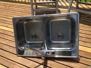 Stainless Steel kitchen sink (double) with faucet. In $30.00.