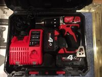 Milwaukee m18 18 volt lithium battery 4 amp drill been use on one job like new