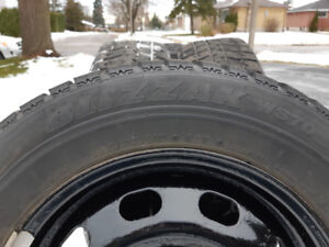 """Blizzack snow tires on 15"""" rims. Must go!"""