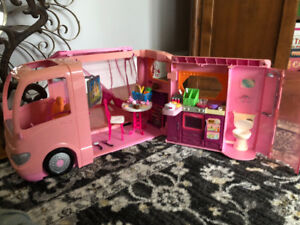 Doll house with Barbie motorocycle and Barbie bus