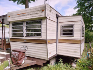 Trailer with add-a-room and shed