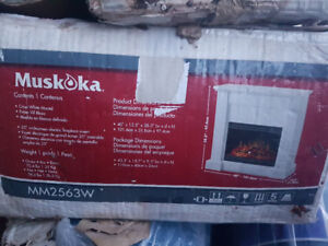 Muskoka Electric Fireplace Mantel and insert new in Box
