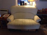 Two beautiful cream vintage sofas