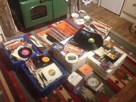 Vinyl records, singles and albums, tapes and CDs