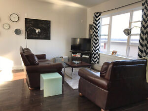 3 Bedroom/4 Bathroom Towhouse minutes from Rotary with Garage!