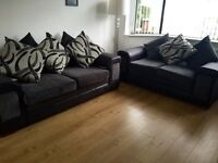 2 and 3seater black and grey sofa