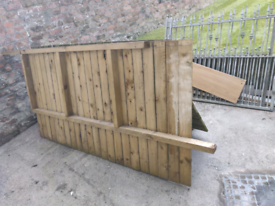 Thick wooden fence 5.27m long and 1.20 m. High