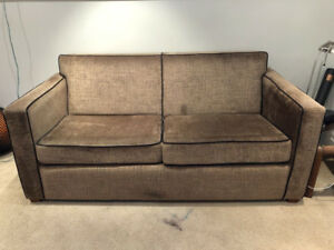 Modern pull out hide-abed couch for sale. Used - in mint shape.