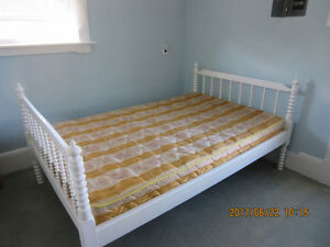 double bed with mattress and kitchen set