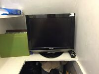 """Sharp LCD colour tv on 20"""" stand and with original remote, full working order"""
