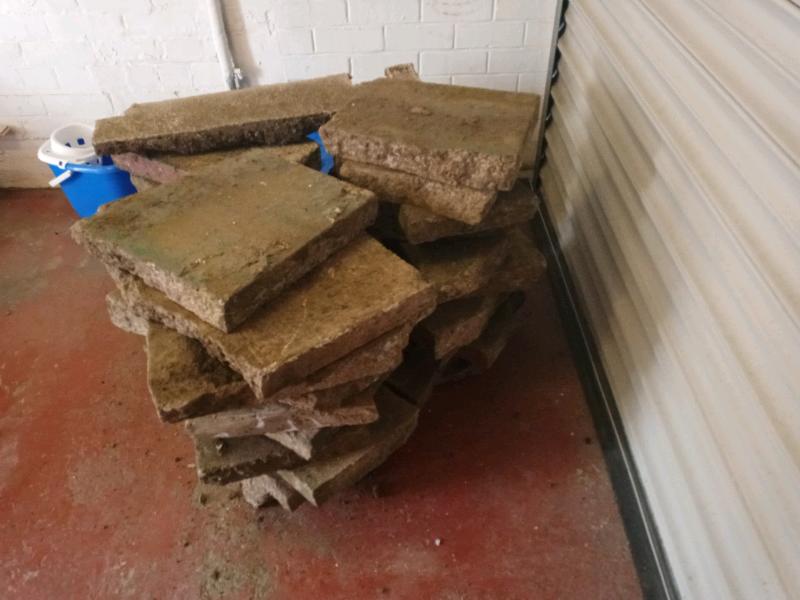 Broken paving slabs plus £20