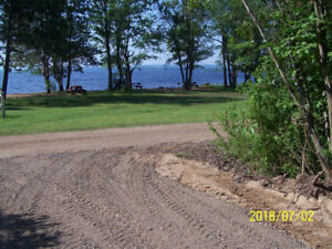 Premium vacant waterfront lot for sale by Owner