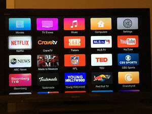 HD SONY FLATSCREEN W/APPLE TV AND TV STAND