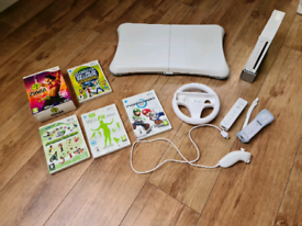Wii Fit with balance board, games and accessories
