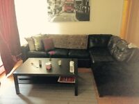 Black leather couch / sectional/pull-out bed