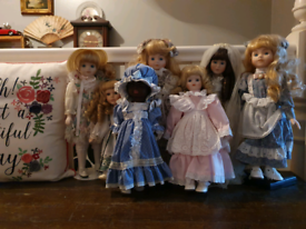Beautiful bundle of vintage dolls with clothes and stands
