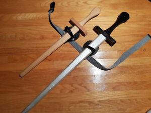 2 wooden swords + 2 holsters $10/OBO FOR BOTH