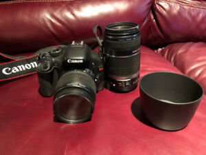 Canon Eos Rebel with two lenses, remote control, lens hood