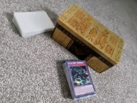 Random YuGiOh Cards with protectors and tin