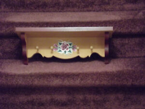 Beautiful toll painted shelf with a flower on it, shelf and pegs