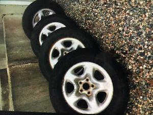 Four Kumho summer tires with rims