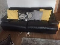 Black leather 3+2 seater sofa with poofy