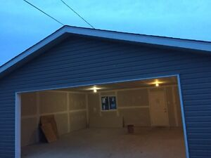 Brand new  insulated double car garage for rent