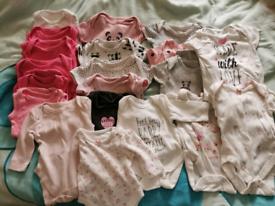 20 Baby vests