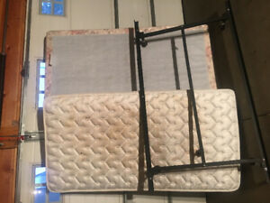 Gently used Daughter's twin sized mattress/box spring/bed frame