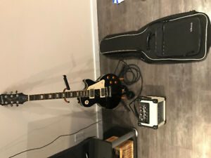 Epiphone Les Paul with cube amp, carrying case, and stand.