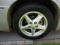 205/55/16 cooper tires with 4k on them-all season-grand am rims
