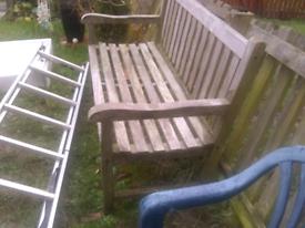 3seater large teak bench.like brand new.curved back slats